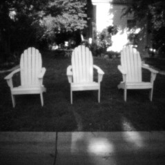 Three white chairs